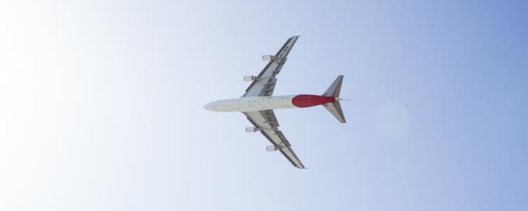 Plane flying across the sky