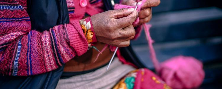 Old woman knitting in south america