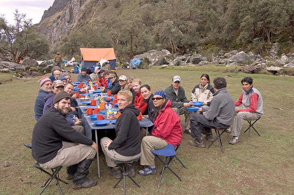 Travellers and guides eat breakfast at Paccha on the Inca trail