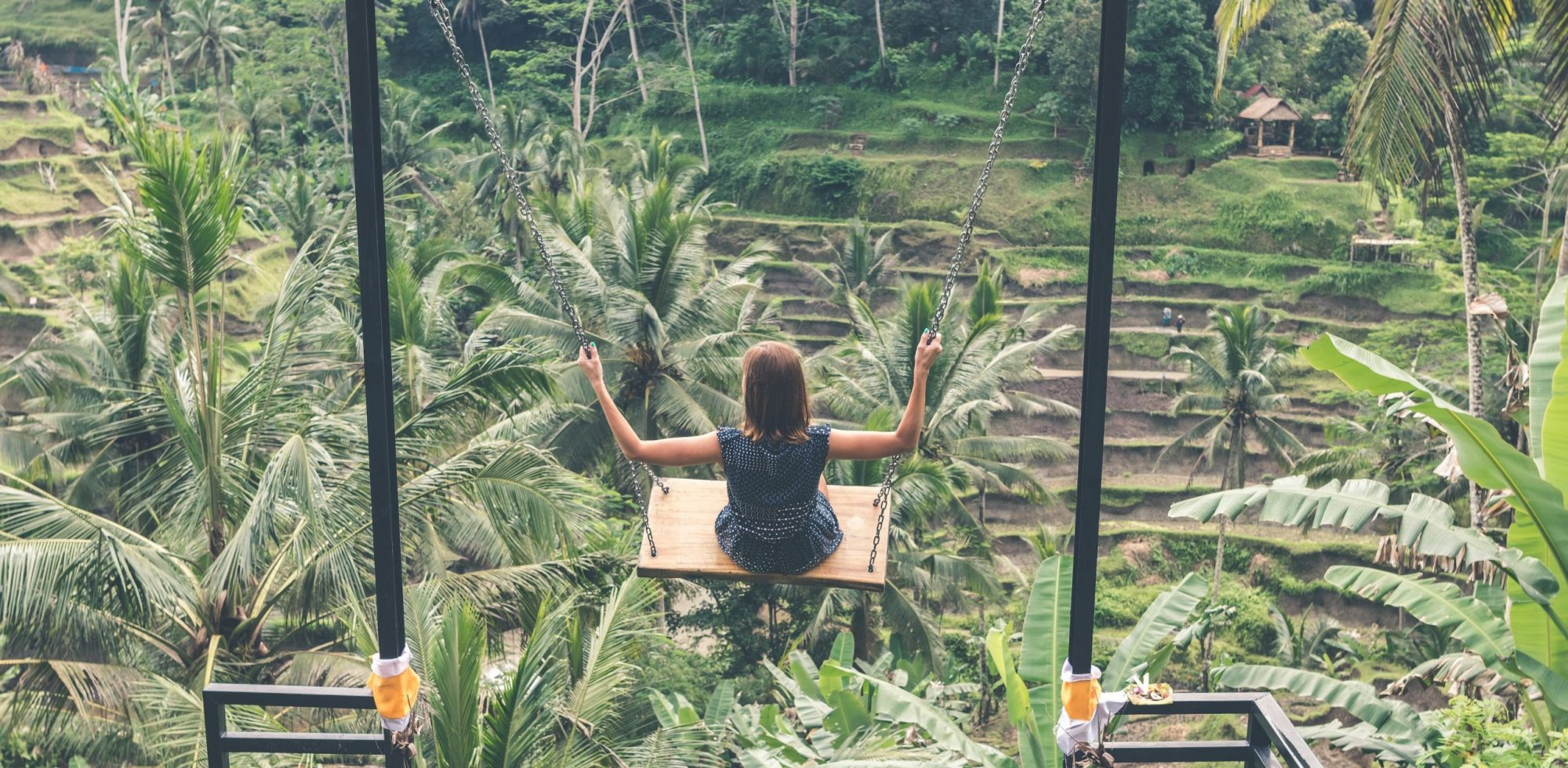 Woman using a swing in the jungle