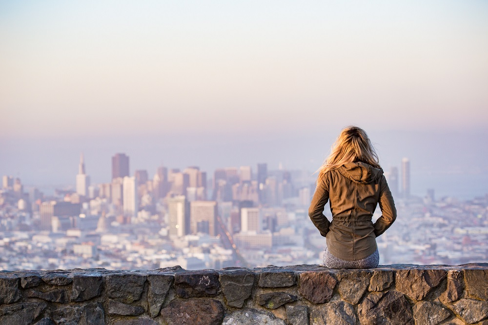 Woman sitting overlooking a cityscape
