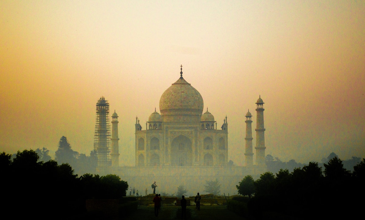 The Taj Mahal at dawn in mist
