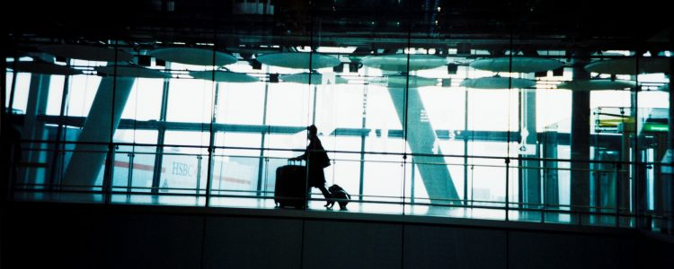Person arriving at an airport with luggage