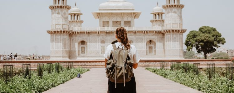 Woman standing looking at a temple in Agra, India
