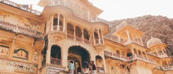 People enter an ornate stone building in India