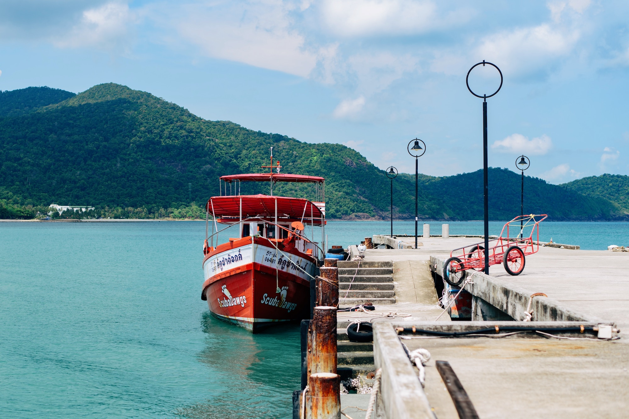 A boat docked on a jetty in Thailand