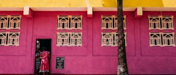 A brightly coloured pink and yellow building in Sri Lanka